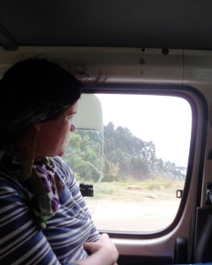 "Tara in Rwanda, Summer 2013, en route to Kibuye/Karongi, where the delegation worked on refugee issues, rights of the historically marginalized ""potter""/""batwa"" people, and visited a hospital and two genocide memorials."