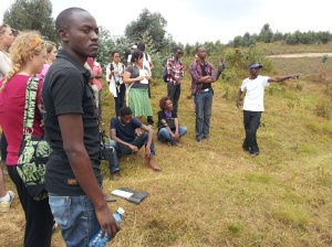 Jean Baptiste and his fellow GYC participants, listening to Augustin on the top of the mountain in Rwanda