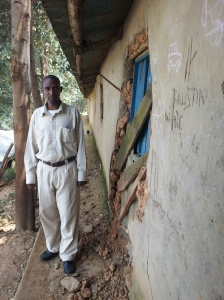 Papa Jonas, father of GYC Alumnus Jonas from Kiziba Camp, pointing out the decrepit state of the primary school at the 19 year old camp. Jonas recently was resettled with his wife to the U.S.A. but the rest of his family, and thousands of youth, remain behind.
